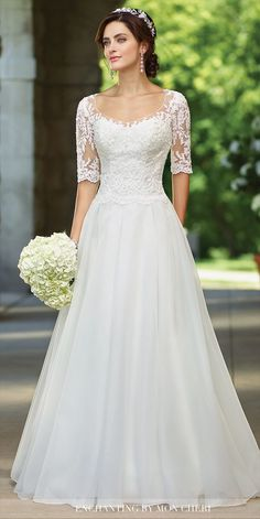 Organza full A-line gown with illusion lace three-quarter length sleeves and scoop neckline, sweetheart lace bodice with scalloped natural waist, illusion lace back with covered buttons, chapel train.