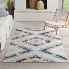 Looking to refresh your living room arrangement or bring a pop of unexpected pattern to the master suite? An area rug will do the trick! This design showcases a Southwestern-inspired pattern perfect for pairing with boho-chic and modern ensembles alike, while its polypropylene construction makes it fade- and stain-resistant. With a pile height of approximately 0.40'', it encourages comfort underfoot while remaining a cinch to keep clean simply by vacuuming.
