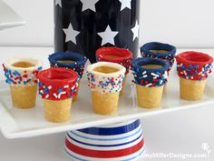 Dip ice cream cones in red white and blue colored chocolate and red white and blue sprinkles for fun festive fourth of july ice cream food fun!