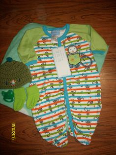 Swaddled Baby Boys Swaddled Monkey Pajama Diaper Cake w/Lt Green Blanket GBOM08 You will receive 1-Micro Fiber Receiving Blanket, 1-Full Body Pajama, 1-Handmade Crochet Beanie,1 Pacifier,1 Pair of Socks & 12 Use-able Diapers.$25.00 free ship