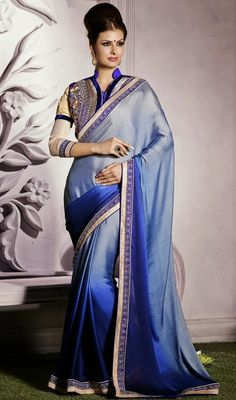 Create an aura of elegance this festive season stepping out in this navy blue and silver shade satin saree. The incredible saree creates a dramatic canvas with wonderful lace and stones work. #LovelyEveningWearSaree