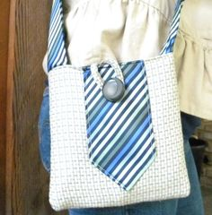tie purse...i have some of my grandpa's old ties from the 60's and 70's that would be great for this!