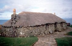 "Kilmuir (Isle of Skye, Scotland), Skye Museum of Island Life (open-air museum: seven thatched-roof cottages of the ""Crofter""). Exterior view of one of the traditional ""Crofter"" cottages.  Photo, 2000."