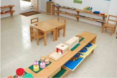 montessori toddler community space. I like the shelves built on the wall.