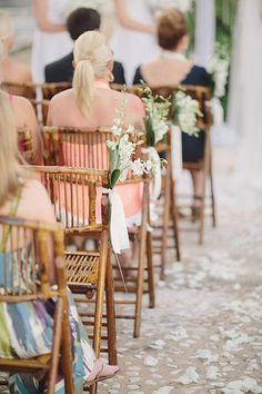 Simple, white ceremony decorations | Brides.com