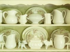 Iron stone pitchers and cow creamers. Love the white.