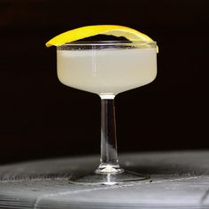 Two Kids in A Cup 2 oz Vodquila (or 1 oz Vodka and 1 oz Tequila blanco) .5 oz Fresh lime juice .75 oz Fresh grapefruit juice .5 oz Simple syrup (one part sugar, one part water) Barspoon Maraschino liqueur 2 dashes Peychaud's Bitters garnish with lemon peel