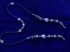 Blue quartz, Murano glass hearts from Italy, Swarowski crystals and antiqued pewter.