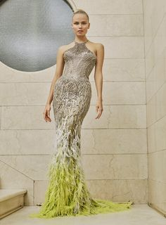 Atelier Versace Spring 2017 Couture: Stunning dress with feathers on the bottom. I like the pop of yellow!