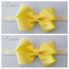 Headband/faixa de cabelo com laço em gorgurao amarelo. <br>pode ser feito em elastico ou bico de pato. <br>10% de desconto nesse valor caso o pagamento seja deposito em conta.