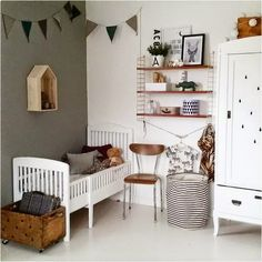 Love the dark wooden touches - a vintage and modern toddler room