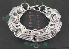 Found at craftingagreenworld.com:  upcycled jewelry from JMP Designs.  I love this pop tab bracelet.