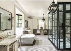 Luxury bathroom with tile flooring   #thevsigroup.com luxury bathroom modern shower tile floor flooring glass double sink vanity two soaking tub vintage antique makeup fixtures silver