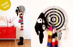 """Okay, hold on while I have a big ol' """"DUH!"""" moment... ...phew, that was intense. Thanks for waiting. But really, how obvious of an awesome coat rack idea is this??! Seriously, guys. Using a bold, graphic dart board as a coat hanger is straight brilliant.  All you need to do is sink those bad boys (akadarts) good and deep into a great-looking dart board, like the one Julia Schenk from the blogPhilukodoes here, and your entryway is set. Simple, practical, and great looking: the three…"""