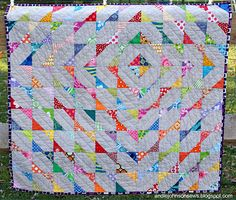 Your next baby quilt pattern will have a gorgeous echo of color coming from a central point using half square triangles and scrap quilt pieces. @Andie Johnson knows just how to make scraps into bold and beautiful new quilt patterns.