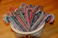 DIY Homespun Candy Canes ~ using plastic Dollar Store candy canes and strips of fabric, glue.