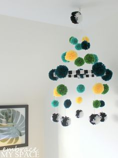 DIY Yarn Pompom Mobile - such a fun pop of color in the nursery!