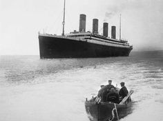 RMS Olympic off Roche's Point; the men in the small boat are in White Star Line uniform.