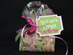 "This gift will be sure to make someone's day... filled with gummy watermelons, the tag reads, ""You're Worth a Melon.""  Two raspberry Seattle chocolates are tied to the outside with a bright ribbon."