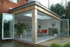 Corner bi-folds with timber clad. Extension Veranda, Conservatory Extension, House Extension Design, Extension Designs, Roof Extension, Extension Google, Extension Ideas, Kitchen Diner Extension, Marquise