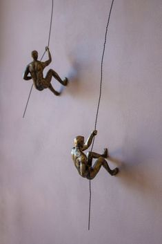Abseiling Man in Antique Gold