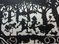 """'Rotten Apples'  The second """"Oz"""" cut.  Notice the detail of the scarecrow shredding straw and the spurs on the tin man.  Can you spot the owl, mouse and squirrel in their hiding places?Dorothy's tiny shoes are even glittery red and dorothy's bunches look so realHand drawn, hand cut papercut from one sheet of paper, a very special feature piece. Finished off with recycled paper backgroundFramed in a massive 19x23 inches ornate frame"""