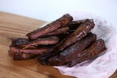 BEEF JERKY:  2 pounds Eye of Round (all fat removed)  1 1/2 tablespoons Kosher Salt  2 teaspoons Granulated Sugar  2 teaspoons Garlic Powder  1 teaspoon Onion Powder  1 teaspoon Cayenne  1 teaspoon Chipotle Powder  1/2 teaspoon ground Coriander  1/2 teaspoon Smoked Paprika  MARINADE 24 HRS, BAKE @ 225 FOR 8 HRS