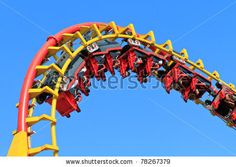 stock photo : Rollercoaster Ride (against blue sky)
