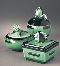 Ceramics by Ilse Claeson. Though not one of the most famous designers from the her black-green pottery with clear Art Deco touches, is easily recognizable. Jaded decorative jars from the Art Deco period.