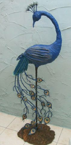 I love peacocks and this paper mache one is completely awesome I think I would use the peacock feathers from the craft store to make the tail though