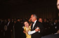 1965: Lady Bird Johnson   PresidentLyndon Johnson dancing with his wife Lady Bird at his inaugural ball. She wore a dress and coat with fur trim by John Moore. (Photo by Stan Wayman/The LIFE Picture Collection/Getty Images)  via @AOL_Lifestyle Read more: https://www.aol.com/article/lifestyle/2017/01/18/first-ladies-inauguration-ball-gowns-50-years/21657651/?a_dgi=aolshare_pinterest#fullscreen