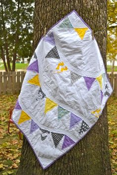 A purple and yellow pennant baby quilt