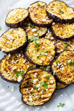 Greek seasoning and Feta cheese top perfectly grilled eggplant slices, making this super healthy, low carb recipe an absolute hit with everyone! Fast and Easy Greek Grilled Eggplant Side Dish Recipes, Veggie Recipes, Vegetarian Recipes, Healthy Recipes, Vegetarian Grilling, Healthy Grilling, Corn Recipes, Cooking Eggplant, Eggplant Dishes