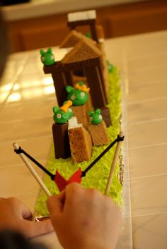 Playable Angry Bird Cake. Easier than you think to make.  Kids love flinging the birds at the pigs and knocking things down.