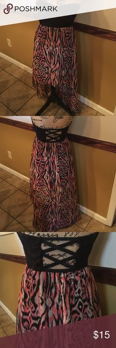Black and peach hi-lo dress Dress is junior's size large. Dress is knee length in the front and long on the back. Dress is strapless and have sweetheart neckline. Dress is black and peach. Dress has been worn but is in good condition Dresses High Low