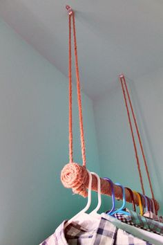 rope wrapped hanging clothes bar via apartmenttherapy not rope wrapped though - fabric maybe? Or just a sanded branch?