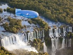 "An airship of ""The New7Wonders of the World"" travels over Iguazu waterfalls in Foz do Iguacu May 26, 2012. The Iguazu Falls was announced as one of the New7Wonders of Nature by the New7Wonders of the World foundation last November. It received a bronze plaque on May 25, 2012 during an official inauguration ceremony.        Email"