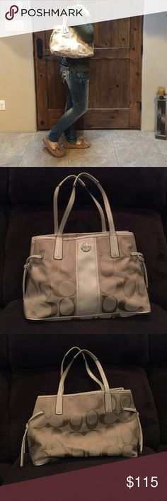 Tan coach purse Tan coach purse with baby pink inside. This purse goes with everything. No snags or stains inside or outside of this purse. This purse has only been worn a handful of times. Inside has 3 different sections. The straps have no peeling or snags. BRAND NEW CONDITION. Not even the bottom of purse has stains. Coach Bags Shoulder Bags