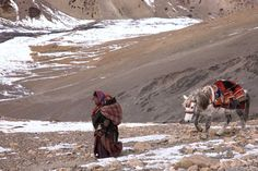 Dolpo-Pa; Mother and child crossing the Himalaya by Cat V Photography