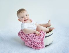 Baby Photos by Jo Frances Wellington, Award Winning Photographer - Smiling baby girl in tub with blanket, by Jo Frances