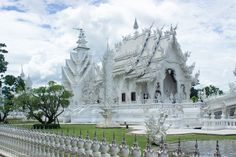 Wat Rong Khun (White Palace), Chiang Rai, Thailand.  A contemporary unconventional Buddhist temple in Chiang Rai Province, Thailand. It was designed by famous Thai artist Chalermchai Kositpipat and was badly damaged by an earthquake in May 2014.