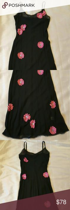 """Vintage 90s Betsey Johnson Slip Dress Black Pink M Gorgeous vintage 1990s sheer black slip dress by Betsey Johnson with hot pink flower appliques with blue and pink boho beading.    Betsey Johnson Evening. Size medium. Actual measurements include 27"""" waist, 34"""" hips, 30"""" bust and 41"""" long.    100% Silk.    No flaws. Pair with solid black slip underneath (not included) or wear as is with black lingerie for a more risqu? look. Betsey Johnson Dresses Midi"""