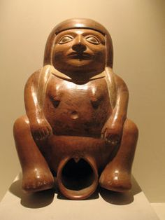 Moche pot of seated woman with huge vaginal opening.