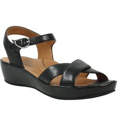 Free shipping and returns on L'Amour des Pieds Casimiro Sandal (Women) at Nordstrom.com. A casual-chic sandal elevates any look with crisscrossed straps, a walkable low heel and a breathable memory-foam lining with arch support for all-day comfort. Black Leather Sandals, 5 Inch Heels, Low Heels, Strap Sandals, Comfortable Shoes, Casual Chic, Memory Foam, Personal Style, Wedges