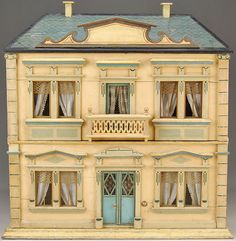 IMAGE: A two-story, four-room, painted Christian Hacker dollhouse with a double-door entrance, balcony, roof and window pediments, corner qu...
