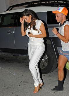 Kim Kardashian - White Zara Jumpsuit, Celine Necklace & Gold Tom Ford Chain Sandals