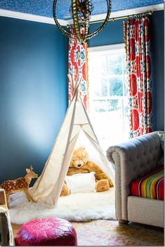 Red, blue, yellow large scale ikat print curtains in a children's room, sophisticated yet fun.