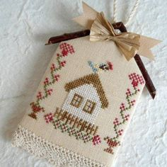 A wonderful bluebird birdhouse cross stitch pattern has been completed and crafted into a charmingly unique garden themed ornament. The stitched work uses a soft and simple color palette of embroidery floss and features a bluebird with flower buds in his Cross Stitch Designs, Cross Stitch Patterns, Cross Stitching, Cross Stitch Embroidery, Diy Broderie, Cross Stitch House, Wedding Cross Stitch, Cross Stitch Finishing, Theme Noel