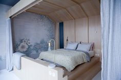 The cabin bedroom with tapestry-inspired painted mural at Chez Marie Sixtine, a guest apartment in Paris, Julie Ansiau photo | Remodelista