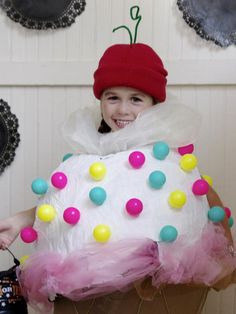 Easy Homemade Halloween Costumes For Kids: It may look vanilla, but it's certainly not plain. To make this scrumptious costume, a laundry basket cone was topped off with a paper-mache scoop then sprinkled with multicolored plastic balls. Add a little chiffon and a cherry-red hat on top. Design by Manvi Drona From DIYnetwork.com